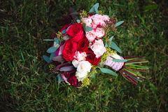 Wedding bouquet on green grass. Bride`s flowers Stock Images