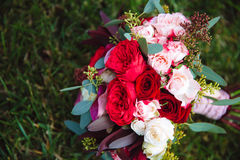 Wedding bouquet on green grass. Bride`s flowers Stock Photo