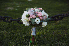 Wedding bouquet on green grass. Bride`s flowers Royalty Free Stock Image