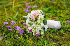 Wedding bouquet on green grass Stock Images