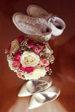 Wedding bouquet with groom and brides shoes Stock Image