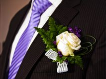 Wedding bouquet with groom Stock Photo