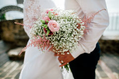 Wedding bouquet in groom's and bride's hands closeup Stock Photography
