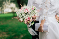 Wedding bouquet in groom's hands closeup Royalty Free Stock Photo