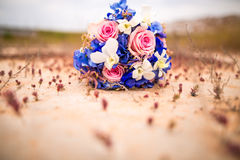 Wedding bouquet on the ground. At sunset Royalty Free Stock Photography