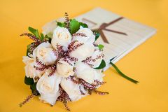 Wedding bouquet and guest book Royalty Free Stock Image
