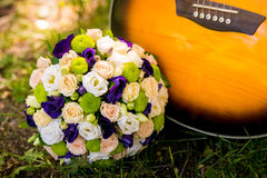Wedding bouquet and guitar Royalty Free Stock Photos