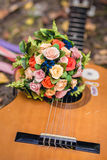 Wedding bouquet and guitar Royalty Free Stock Photography