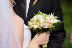 Wedding bouquet in hand Royalty Free Stock Photos