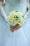 Wedding bouquet in hand Royalty Free Stock Photo