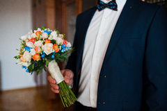 Wedding bouquet at hand Royalty Free Stock Image