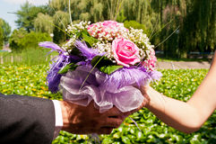 Wedding bouquet in hands Stock Image