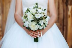 Wedding bouquet in the hands. Of bride Royalty Free Stock Photography