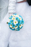 Wedding bouquet in hands of the bride Royalty Free Stock Image