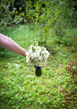 Wedding bouquet in hands of the bride Royalty Free Stock Photos