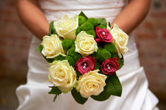 Wedding bouquet. In hands of a bride Royalty Free Stock Photos