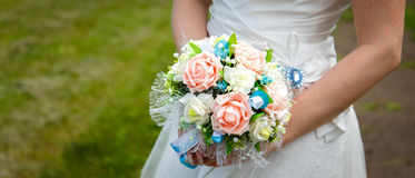Wedding bouquet in hands of the bride Stock Photography