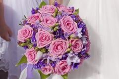 Wedding bouquet in hands of bride. Beautiful wedding bouquet in hands of bride Stock Images