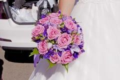 Wedding bouquet in hands of bride. Beautiful wedding bouquet in hands of bride Stock Image