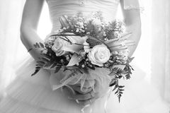 Wedding bouquet in hands of bride Royalty Free Stock Images