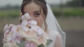 Wedding bouquet in the hands of the bride. Wedding day. Engagement. Pretty and well-groomed woman. Slow motion stock video footage