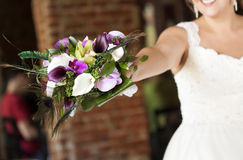 Wedding bouquet in hands of the bride Royalty Free Stock Images