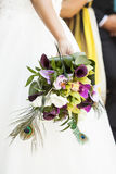 Wedding bouquet in hands of the bride Stock Images