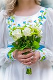 Wedding bouquet in the hands of the bride in the national Ukrainian dress Stock Image