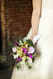 Wedding bouquet in hands of the bride. Old styled photo. Stock Images