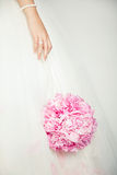 Wedding bouquet in hands of bride Royalty Free Stock Photography
