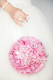 Wedding bouquet in hands of bride Stock Photo