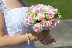Wedding bouquet in hands of bride Stock Photos