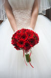 Wedding bouquet in hands of the bride. Royalty Free Stock Photos