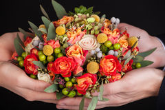 Wedding bouquet in hands. Of the bride with wedding rings Royalty Free Stock Photography