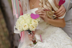 Wedding bouquet in hands of the bride of roses Royalty Free Stock Photo
