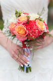 Wedding bouquet in the hands of  bride Royalty Free Stock Photography