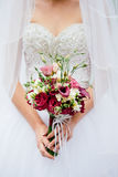 Wedding bouquet in the hands Stock Images