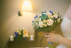 Wedding bouquet in hands Stock Image