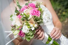 Wedding bouquet in the hands of the bride stock photos