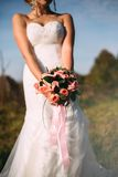 Wedding bouquet in hands of the bride. Sunset Royalty Free Stock Photo