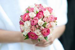 Wedding bouquet in hands of the bride. White and pink roses Stock Images