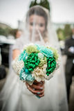 Wedding bouquet in hands Stock Photography