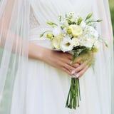 Wedding bouquet in hands outdoor Royalty Free Stock Photos