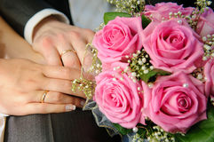 Wedding Bouquet with hands and rings. Newly-married couple with Wedding Bouquet and hands and rings Stock Photos