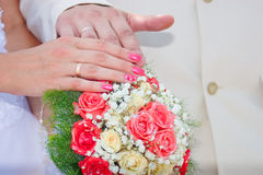 Wedding bouquet, hands and rings. Wedding bouquet from white and ping roses, hands and rings royalty free stock photography