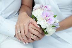 Wedding bouquet with hands and rings Stock Photo
