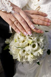 Wedding bouquet and hands with rings. Royalty Free Stock Photos