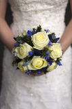 Wedding bouquet held by a bride Royalty Free Stock Images