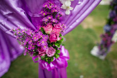 Wedding bouquet. The wedding holding flowers on the green grass Royalty Free Stock Image