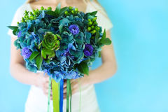 A wedding bouquet with hydrangea in blue and green colors outdoo Stock Photography